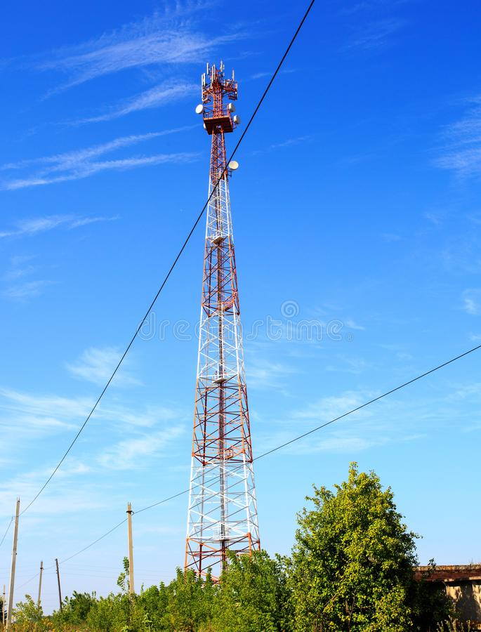 Red and white communication tower with beautiful clear sky. White and red electric pole panorama, electricity transmission line to house, high voltage post stock photography