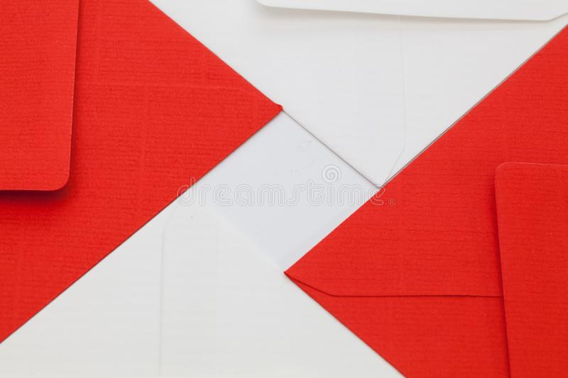 White and red envelopes on the table. Pattern from white and red envelopes on the white table royalty free stock photos