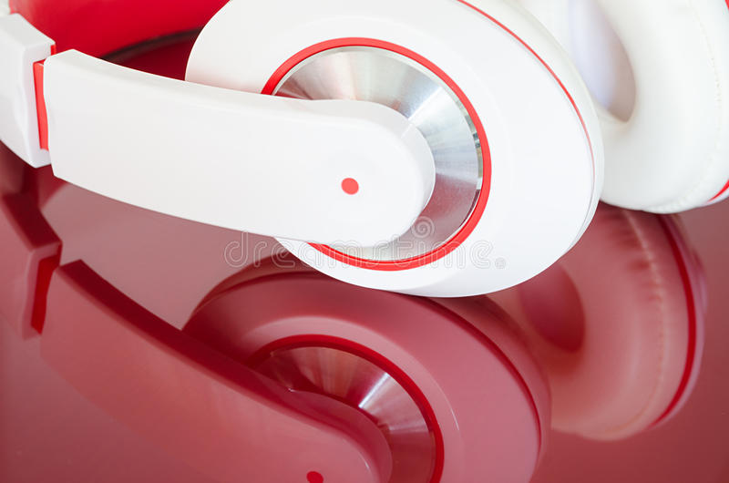 White red headphones on vinous surface royalty free stock photos