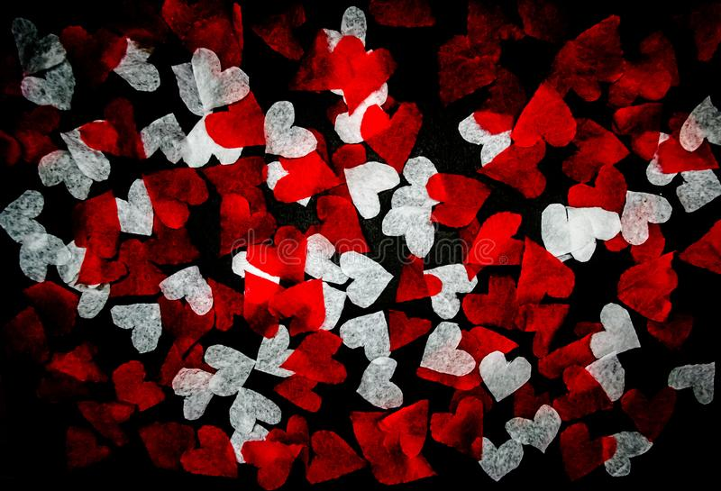 White and red hearts cut from paper stock photography