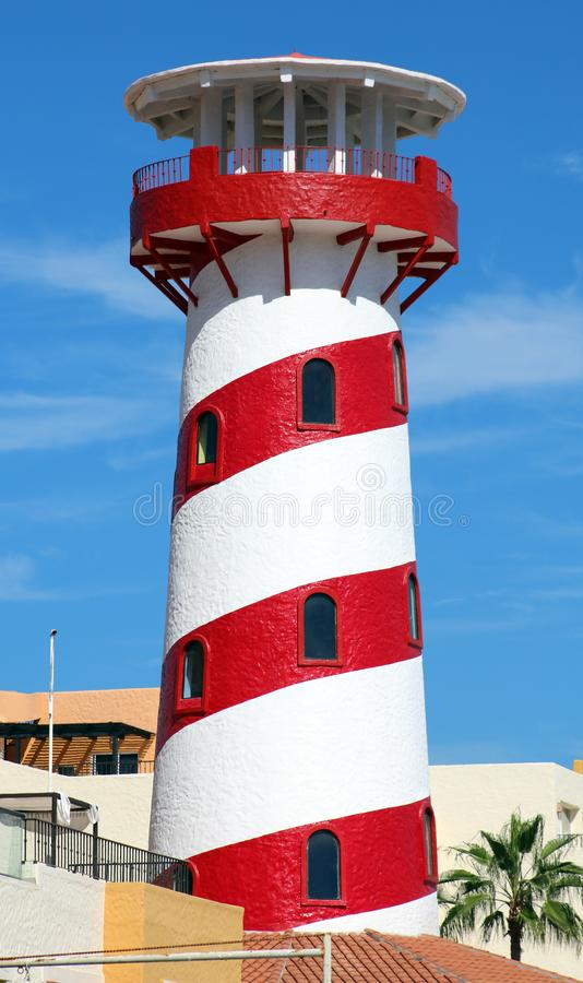 White and red lighthouse in Los Cabos Mexico stock photography