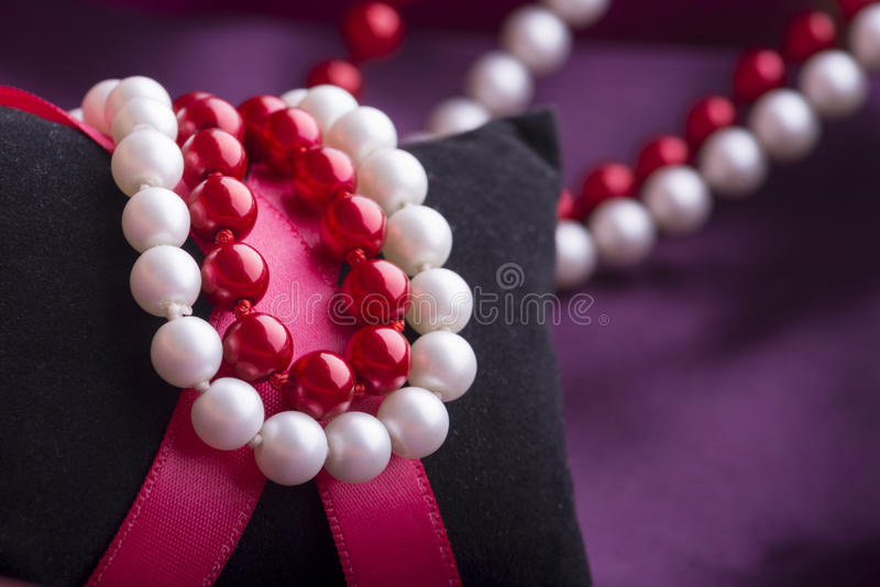 White and Red Pearl Necklace royalty free stock images