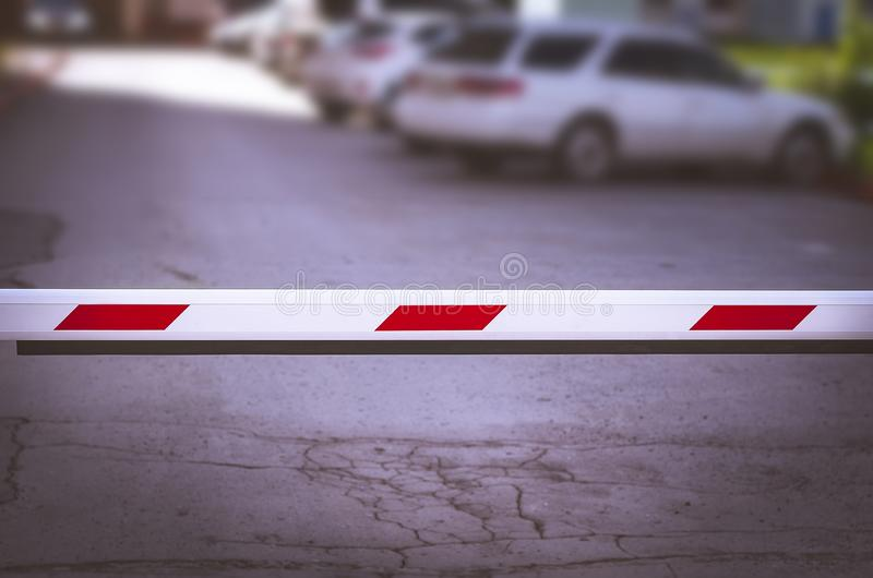 White and Red Security Boom Barrier Gate at the Car Parking Lot for Access Control. Border Control Point. Trade War, Tariffs royalty free stock images