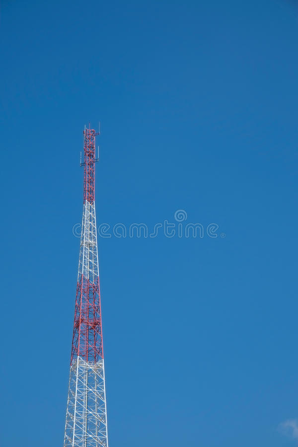 Telecommunication tower. White red steel telecommunication tower in blue sky stock photos