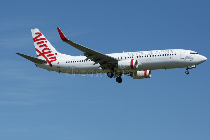 White and Red Virgin Australia Airplane Mid Air Under Blue and White Sky during Daytime royalty free stock photography