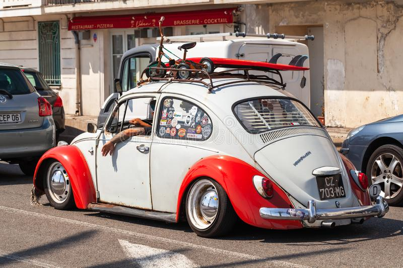 White red Volkswagen beetle stock photography
