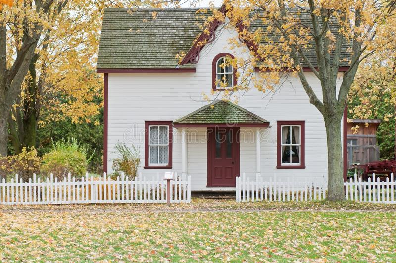 White and Red Wooden House With Fence stock photos