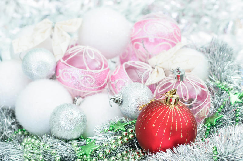 White and red xmas ornaments and Christmas balls on glitter holiday background. Merry christmas card. Winter holidays. Xmas theme. The white and red xmas stock photo