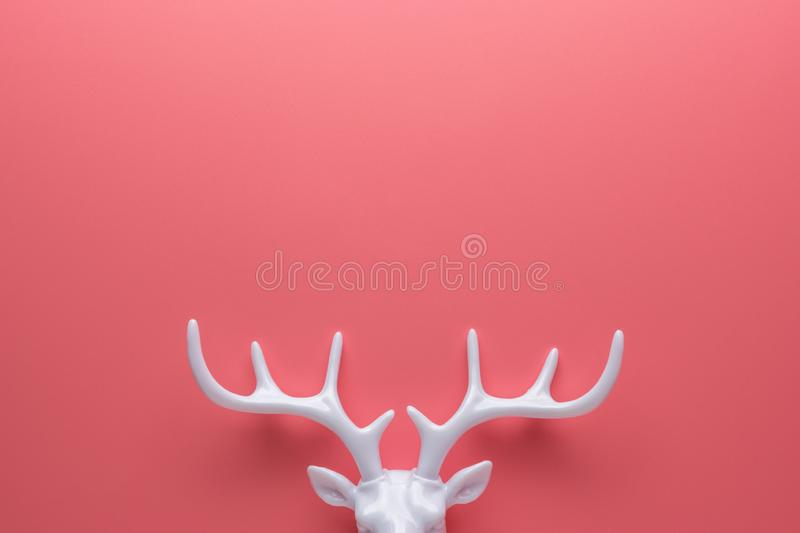 White reindeer antlers on bright pink background. Minimal New Year or Christmas concept. Flat lay.  stock image