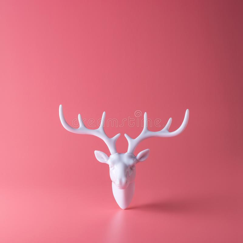 White reindeer with white antlers. Minimal New Year or Christmas background concept.  stock photos