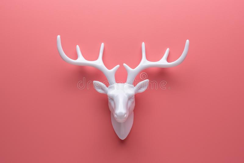 White reindeer with white antlers. Minimal New Year or Christmas background concept.  stock photo