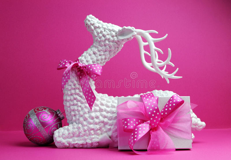 White reindeer, pink bauble and present gift festive holiday Christmas still life stock image