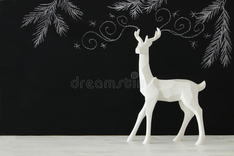 Download White Reindeer On Wooden Table Over Chalkboard Background Whith Hand Drawn Chalk Illustrations. Stock Image - Image of decoration, deer: 99616961