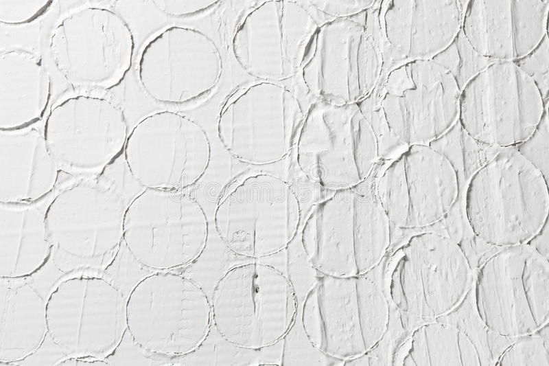 White relief pattern, plaster texture background. White relief pattern, creative design, stucco structure. Wet plaster building background with free space for royalty free stock photo
