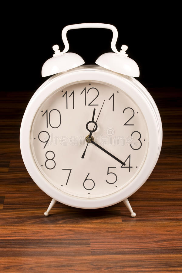 White retro alarm clock stock image