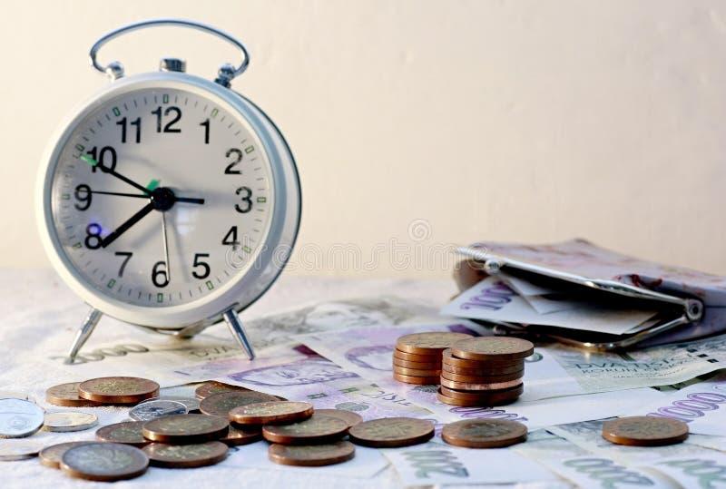 Alarm clock and money stock photo