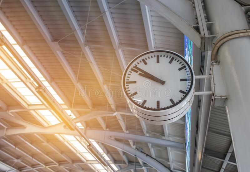 White retro big clock show time an instrument to measure for traveler and people at BTS skytrain station bangkok Thailand with stock photo