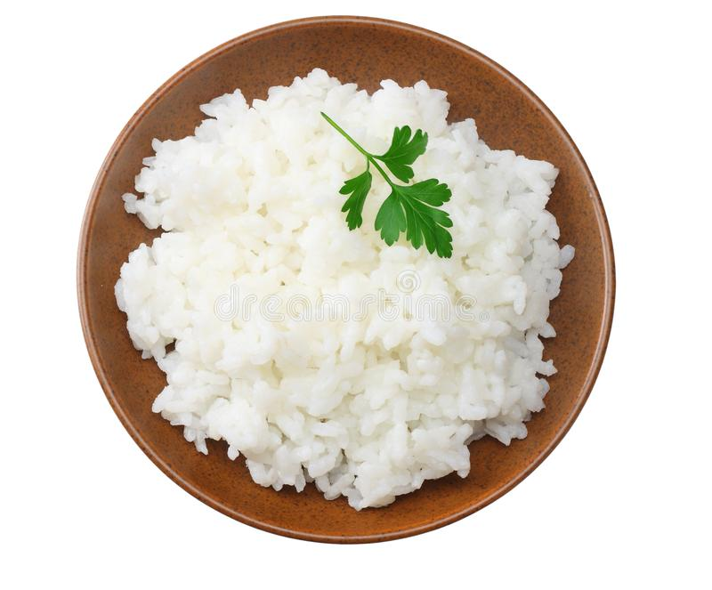 White rice in brown bowl isolated on white background. top view stock photo