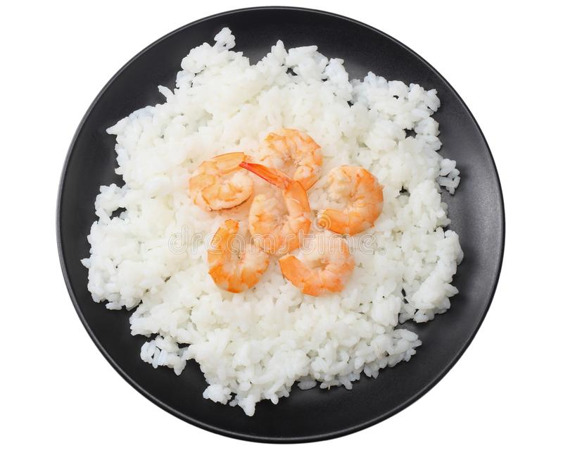 White rice with shrimps in black bowl isolated on white background. top view stock photography
