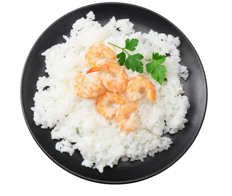 White rice with shrimps in black bowl isolated on white background. top view royalty free stock image