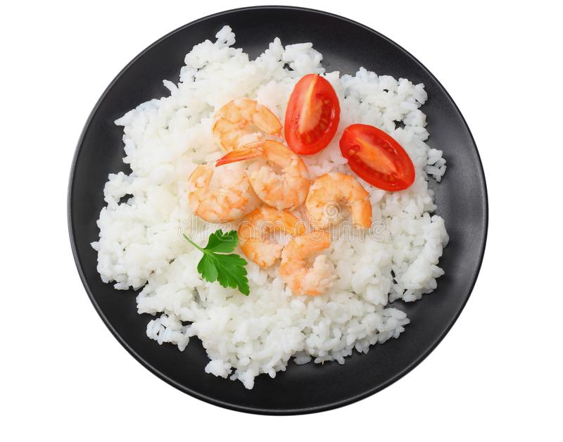 White rice with shrimps in black bowl isolated on white background. top view stock images