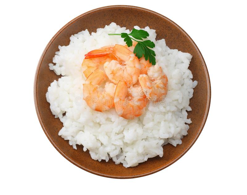 White rice with shrimps in brown bowl isolated on white background. top view stock images