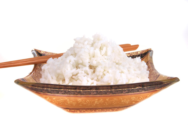 White rice and sticks stock photography