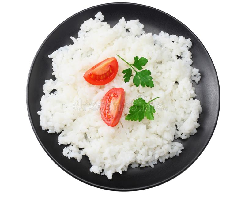 White rice with tomato in black bowl isolated on white background. top view royalty free stock photos