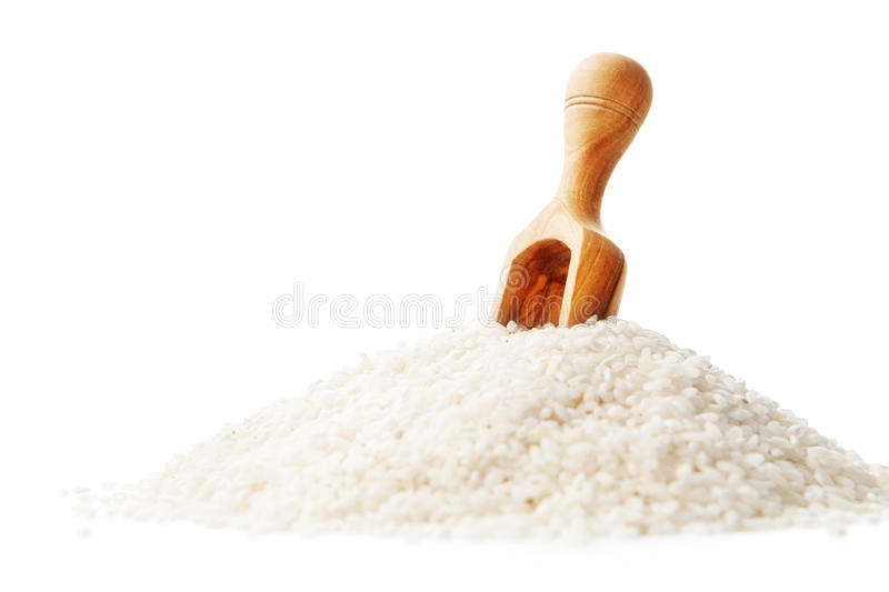 White rice and wooden spoon