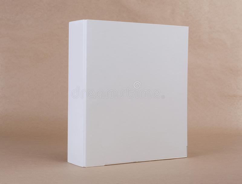 A white ring binder on beige background. stock photos