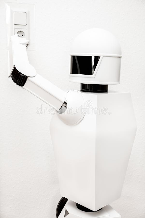 White robot is recharging himself royalty free stock photography