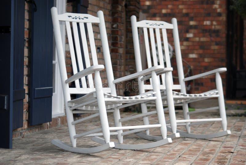 White Rocking Chairs royalty free stock image