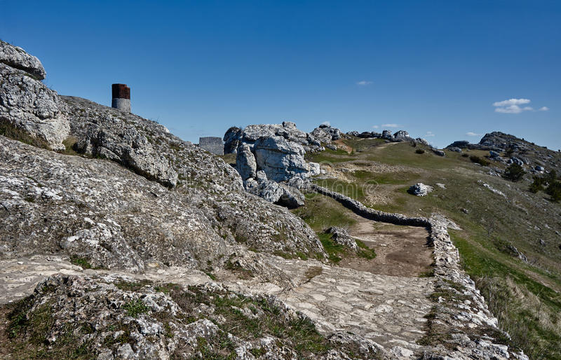 White rocks and ruined medieval castle royalty free stock photography