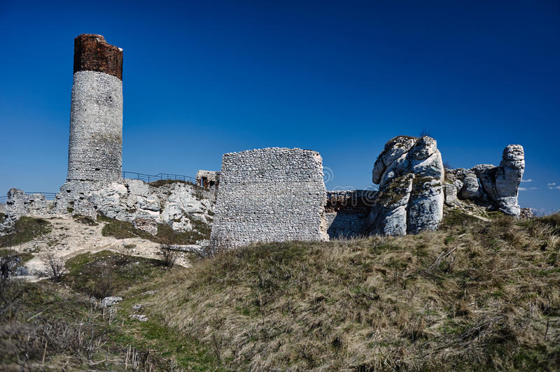 White rocks and ruined medieval castle royalty free stock image