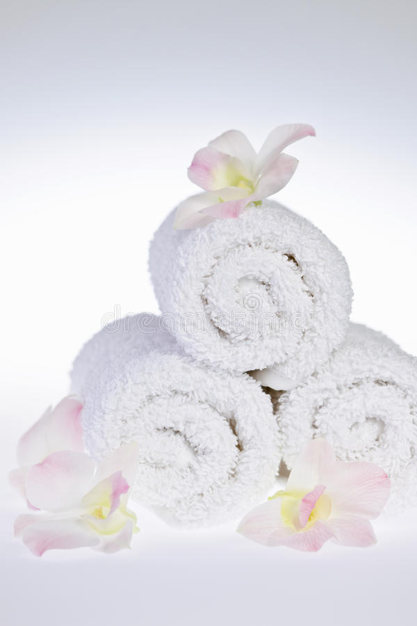 White rolled up spa towels royalty free stock photo
