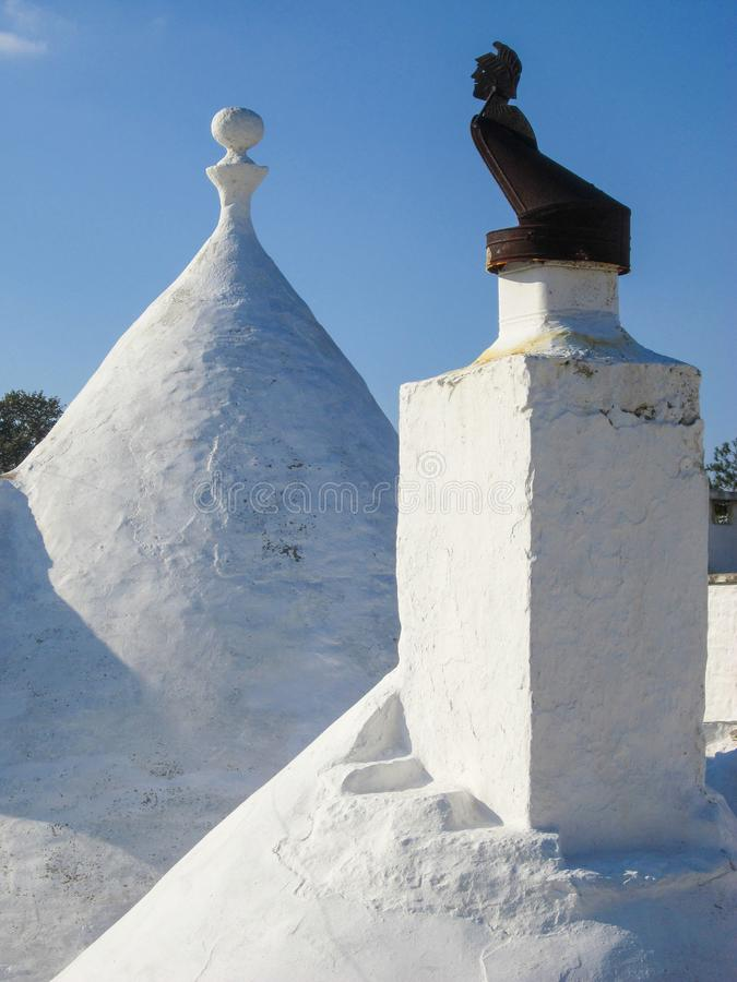 White roof with chimney top, Trulli stock photo