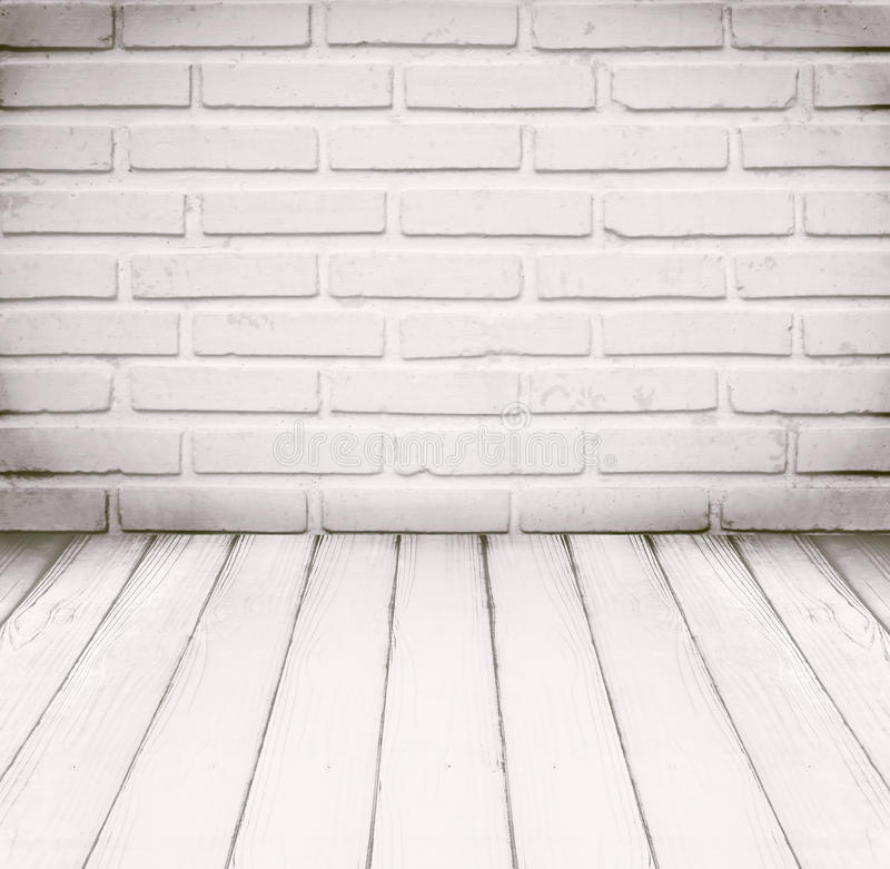 White room, brick wall and wood floor for background.  royalty free stock photo
