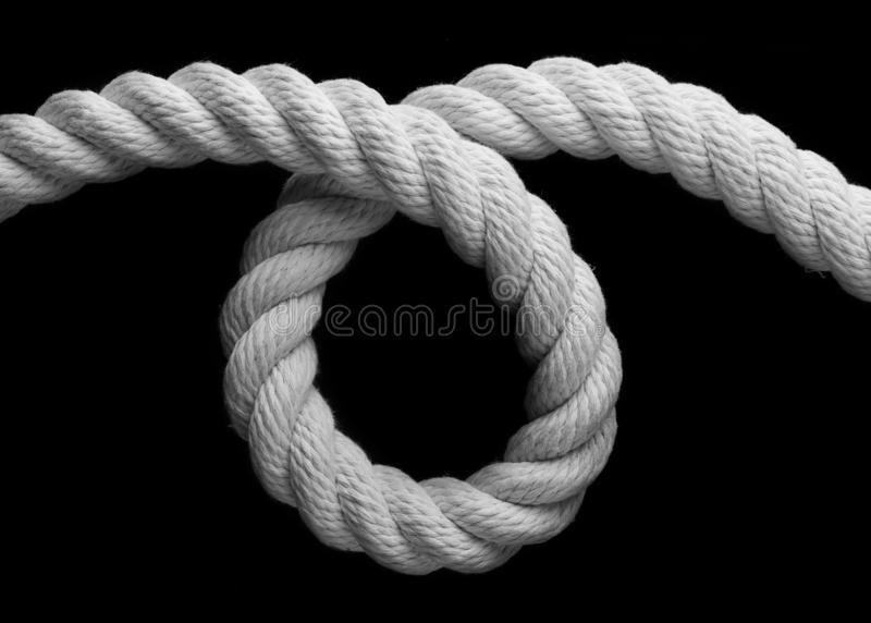 White rope twisted into a loop royalty free stock image