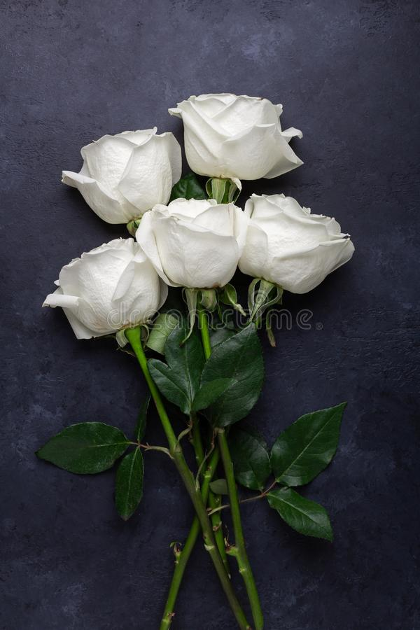 White rose flowers bouquet on black stone background Valentine's day greeting card royalty free stock photo