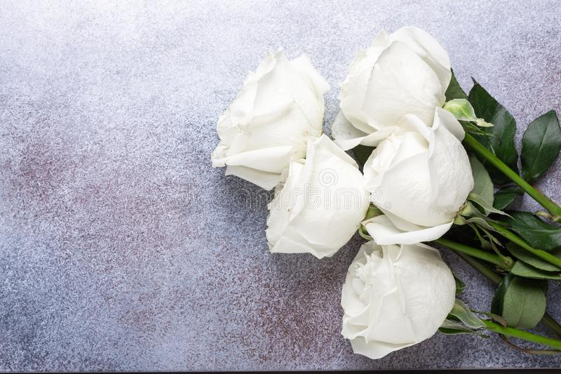 White rose flowers bouquet on light gray stone background royalty free stock photography