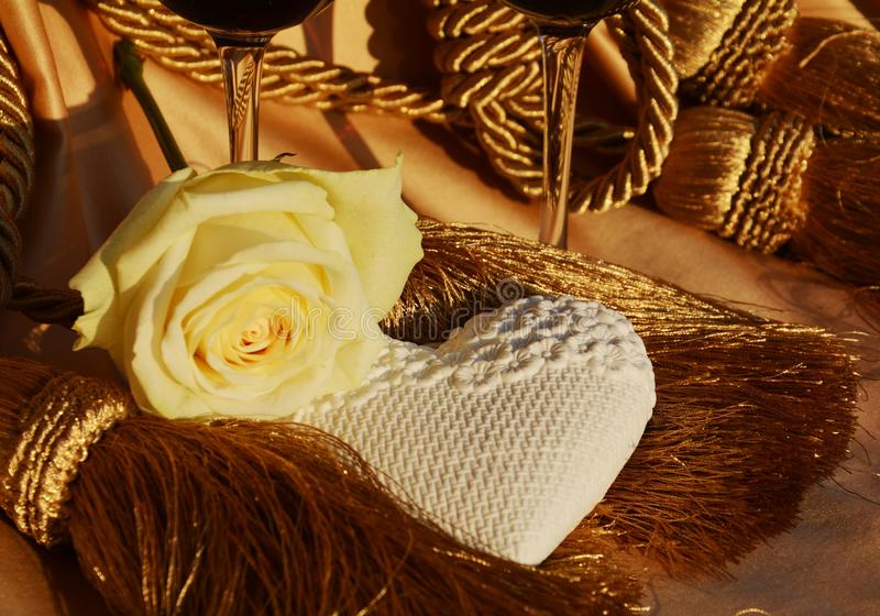 White rose, heart and joyful play of golden hues royalty free stock photography