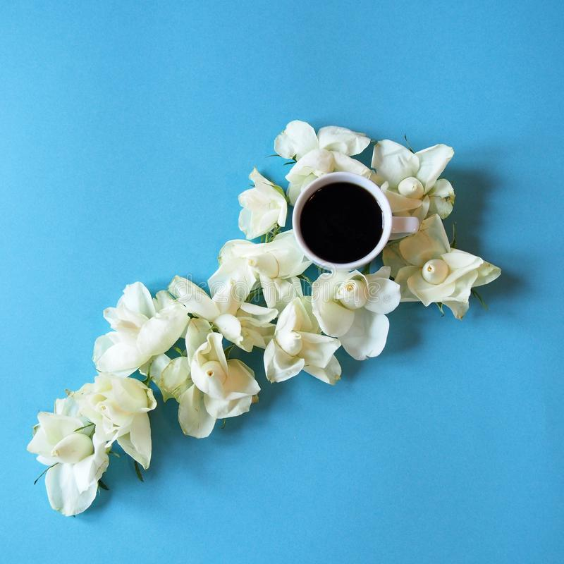 White roses with a cup of coffe royalty free stock images