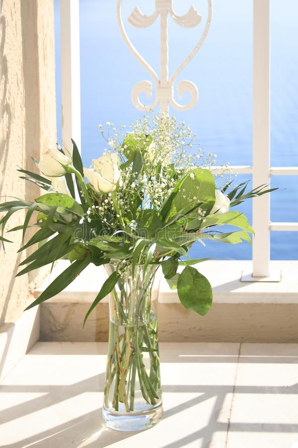 White roses in a glass vase royalty free stock images