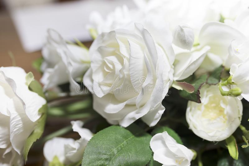 White roses wedding bouquet of flowers shot close up with a shallow depth of field at a tradtional English Wedding stock photo