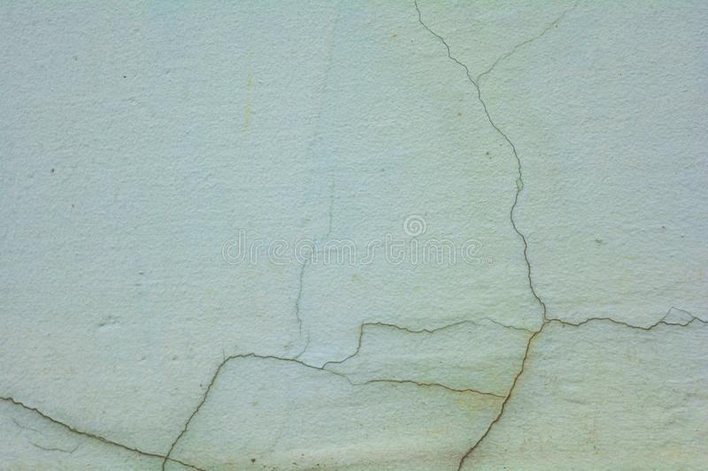 White rough concrete wall with cracks stock images