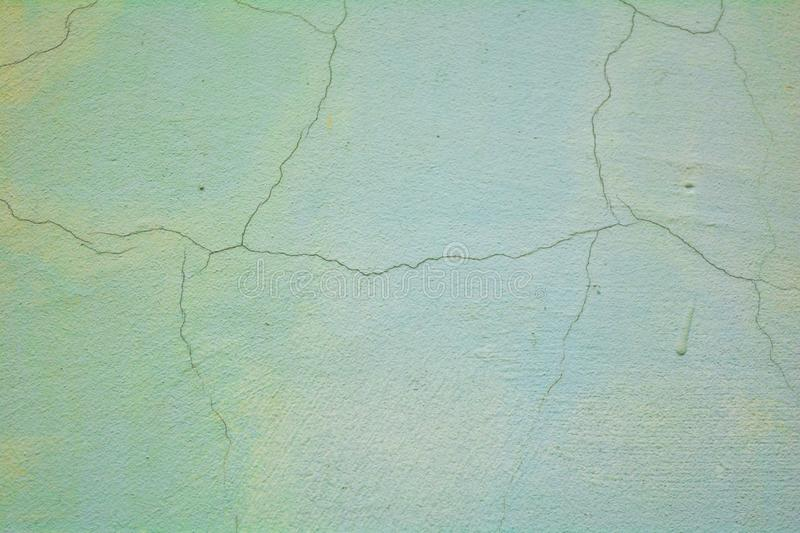 White rough concrete wall with cracks stock photography