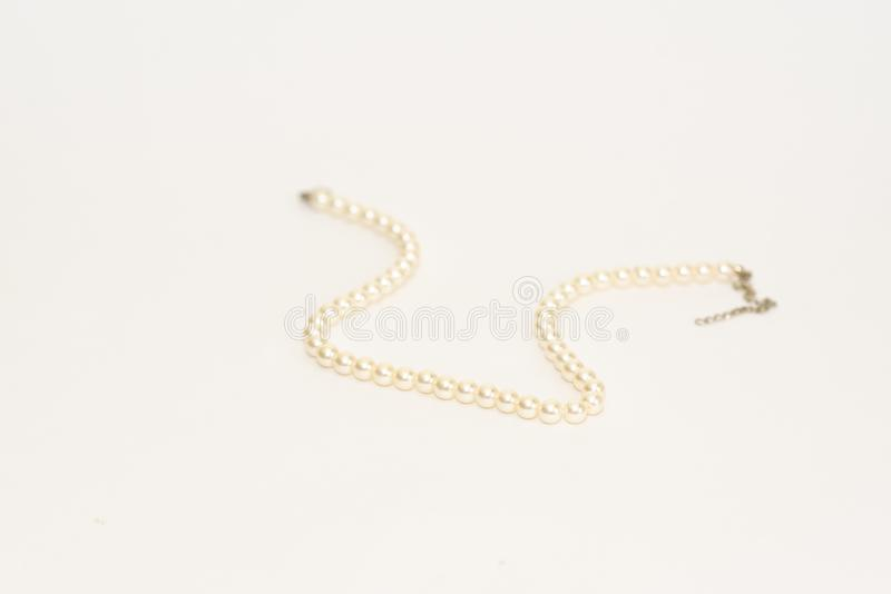 White round elastic bracelet made of medium pearl-like round beads, isolated on white background, clipping path included royalty free stock photo
