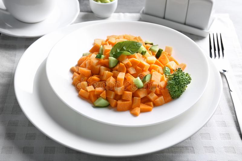 White round plate with delicious carrot salad royalty free stock image