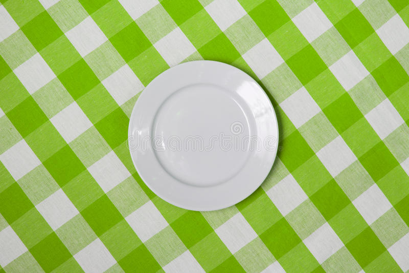 Download White Round Plate On Green Checked Tablecloth Stock Image - Image: 21682725