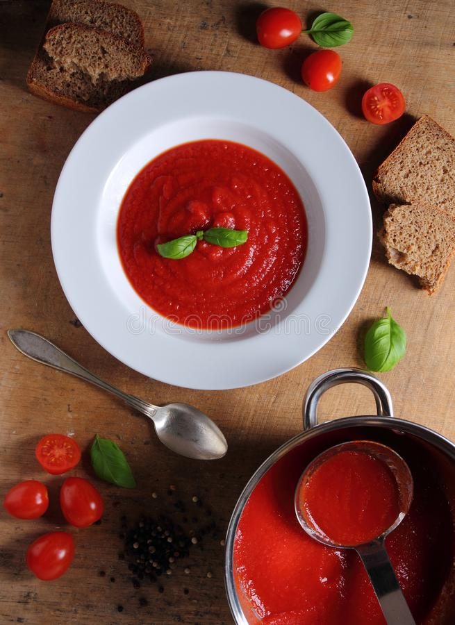 White round plate with tomato soup stock image
